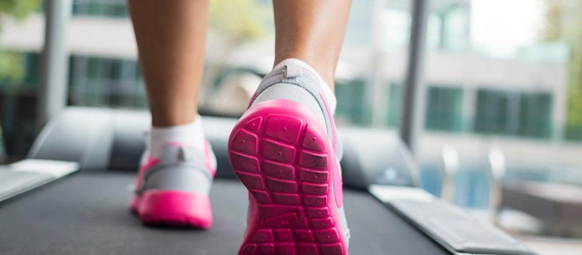 Jogging on treadmill, focus on the treadmill, blurred motion